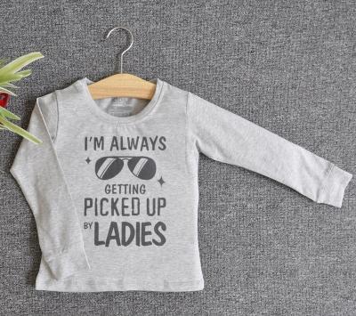 TDE7002 - Áo thun trẻ em cổ tròn tay dài in chữ I'm Always Getting Picked Up By Ladies (Đen)